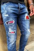 Blue Acid Wash Ripped Patched Skinny Jeans