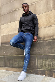 Blue Skinny Jeans With Knee Rips And Raw Hem