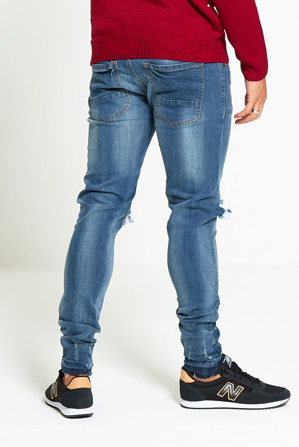 Washed Denim Ripped Knee Skinny Jeans
